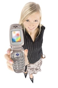 headshot of young blonde woman with moble phone